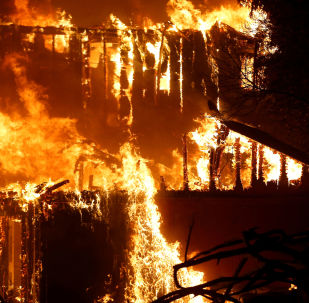 A structure burns during the Kincade fire in Geyserville, California