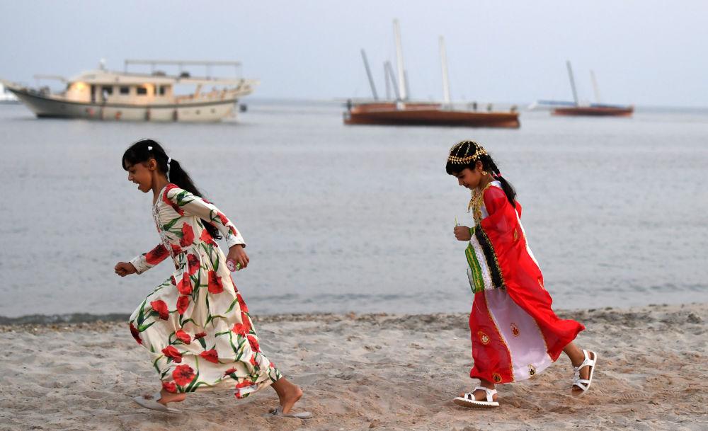 Emirati girls run on the shore, off the coast of Dalma island in the Gulf, about 40 kilometres off of the Emirati capital Abu Dhabi on October 21, 2019.