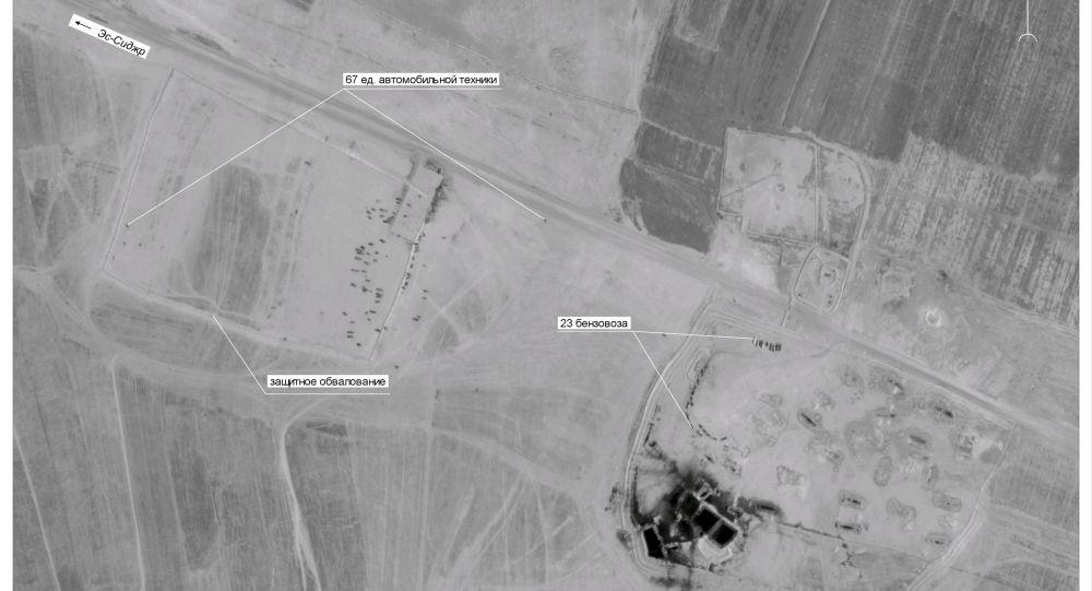 Oil transit vehicles gather near Tall Daman oil station in Syria, 43 km east of Deir ez-Zor