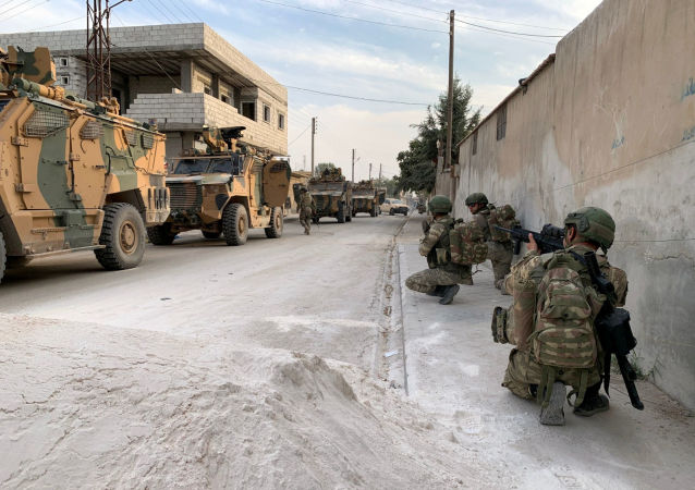 Turkish soldiers are seen in the border town of Tal Abyad, Syria, in this undated handout photo released by Turkish Defence Ministry on October 17, 2019