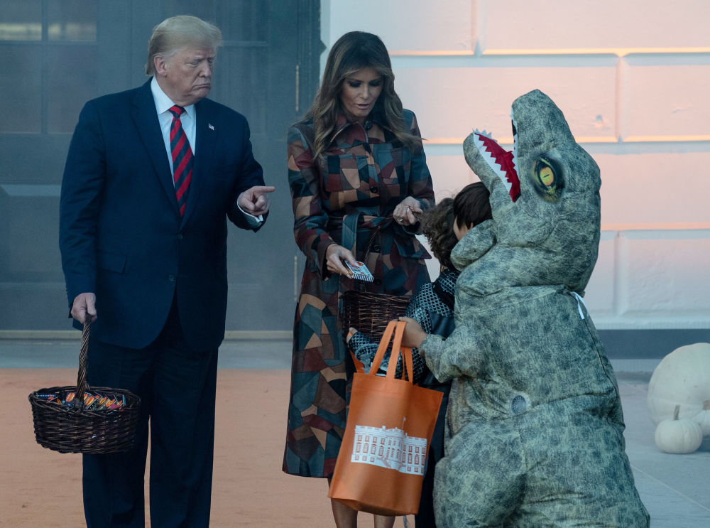 US President and First Lady Melania Trump arrive to hand out candy for children at a Halloween celebration at the White House in Washington, DC, on October 28, 2019.