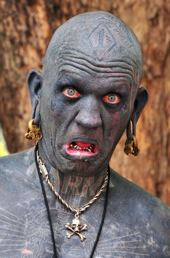 Lucky Diamond Rich from New Zealand, who in 2006 earned the Guinness World Record as the world's most tattooed person. His body is 100 per cent tattooed, including the insides of his eyelids, mouth, ears and foreskin.