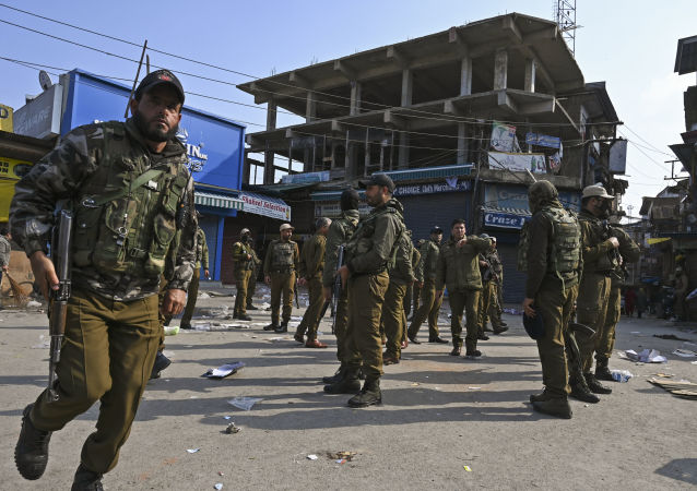 Soldiers evacuate an injured comrade after a grenade blast at a market in Srinagar on November 4, 2019.
