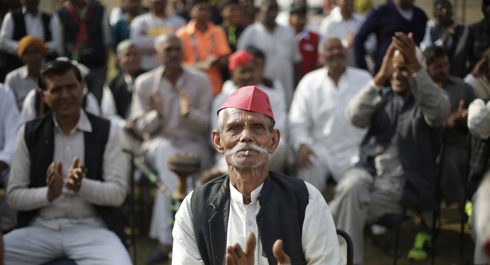 In this Feb. 2, 2017, file photo, a supporter applauds as he listens to Samajwadi Party candidate Sunil Choudhary during a election campaign