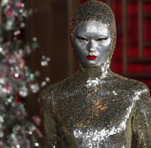 A model presents a creation from Valentino Haute Couture collection by designer Pierpaolo Piccioli during a fashion show at the Aman Summer Palace in Beijing, Thursday, Nov. 7, 2019.