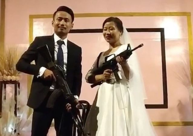 NSCN (U) leader's son and daughter-in-law pose with assault rifles at wedding function
