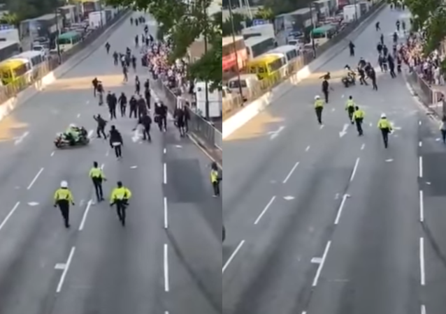 The Hong Kong police are facing backlash online over a viral video of an officer driving into a group of protesters on the road.