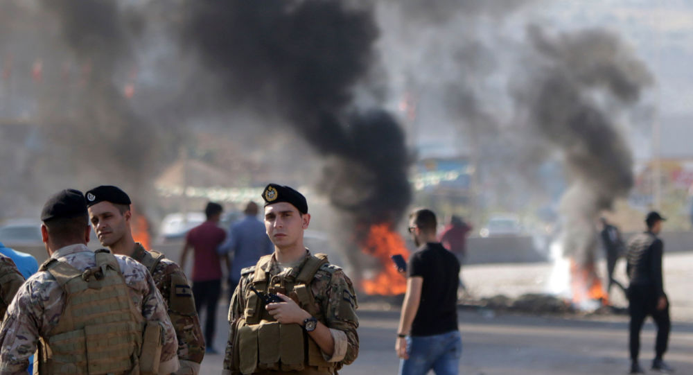 Lebanese security forces at a blocked road in Tripoli