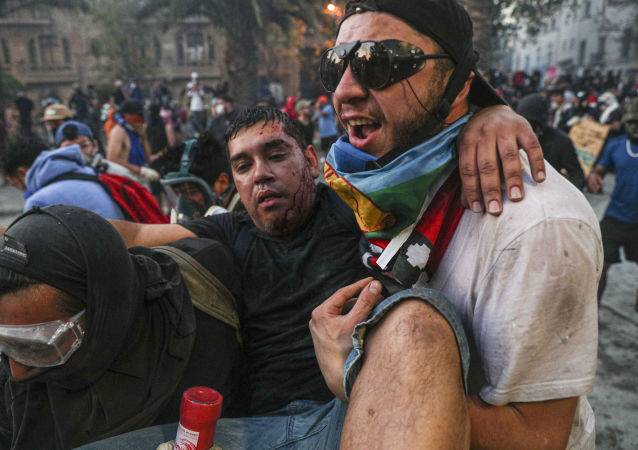 An injured anti-government demonstrator in Santiago