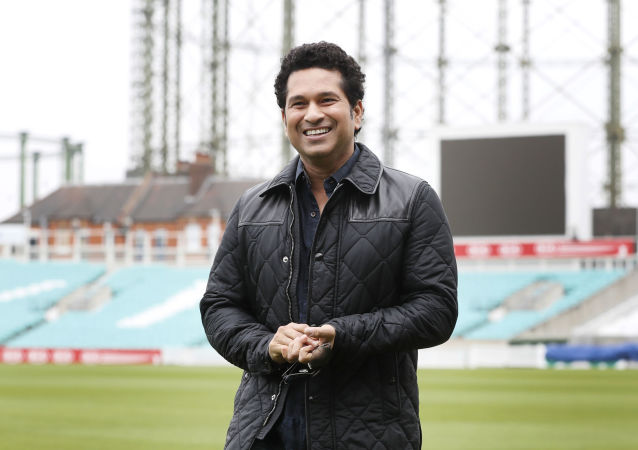 Indian former cricket player Sachin Tendulkar smiles as he walks around the pitch at the Oval cricket ground to promote his upcoming film, in London, Saturday, May 6, 2017