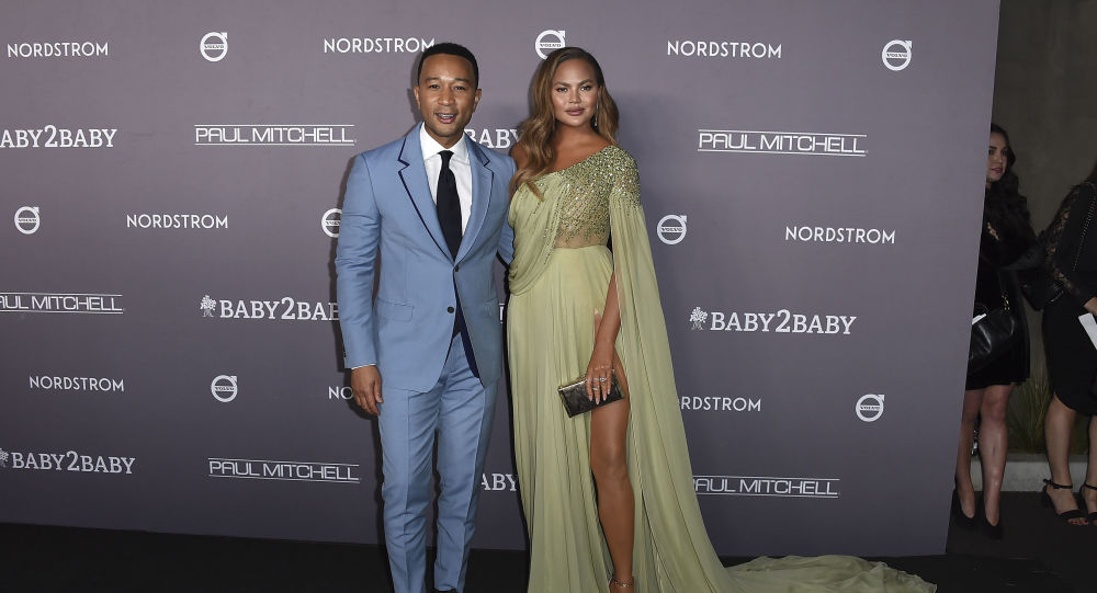 John Legend and Chrissy Teigen arrive at the 2019 Baby2Baby Gala on Saturday, Nov. 9, 2019, in Culver City, Calif.