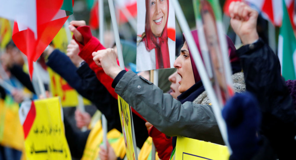 People attend a protest organised by National Council of Resistance of Iran in Germany to support nationwide demonstrations in Iran against the rise in gasoline prices, in Berlin, Germany November 17, 2019