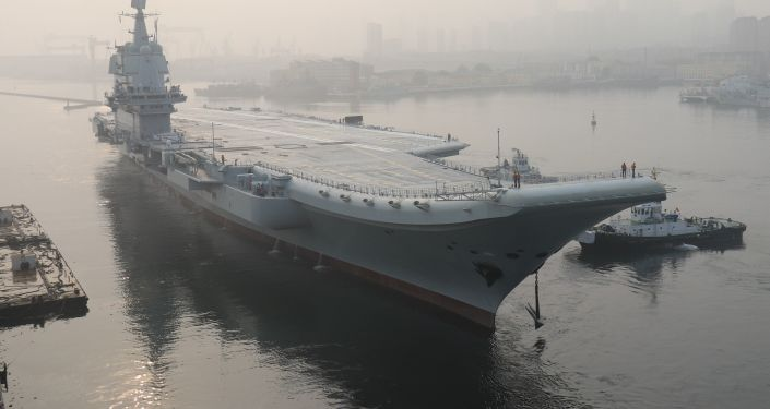 (FILES) In this file photo taken on May 13, 2018, China's first domestically manufactured aircraft carrier, known only as Type 001A, leaves port in the northeastern city of Dalian