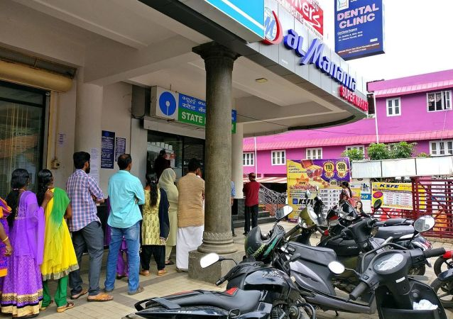 People standing in queue in front of SBI Bank ATM at Paravur near Kollam city in Kerala