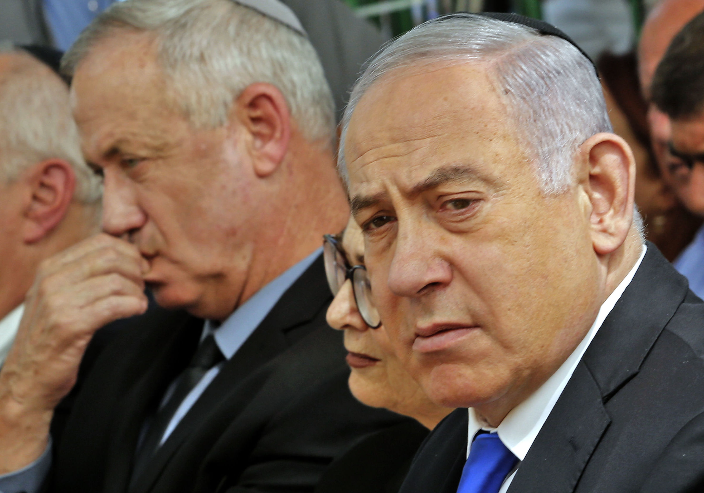 Israeli Prime Minister Benjamin Netanyahu (R), Israeli president of the Supreme Court  Esther Hayut (C) and Benny Gantz (L), leader of Blue and White party, attend a memorial ceremony for late Israeli president Shimon Peres, at Mount Herzl in Jerusalem on September 19, 2019