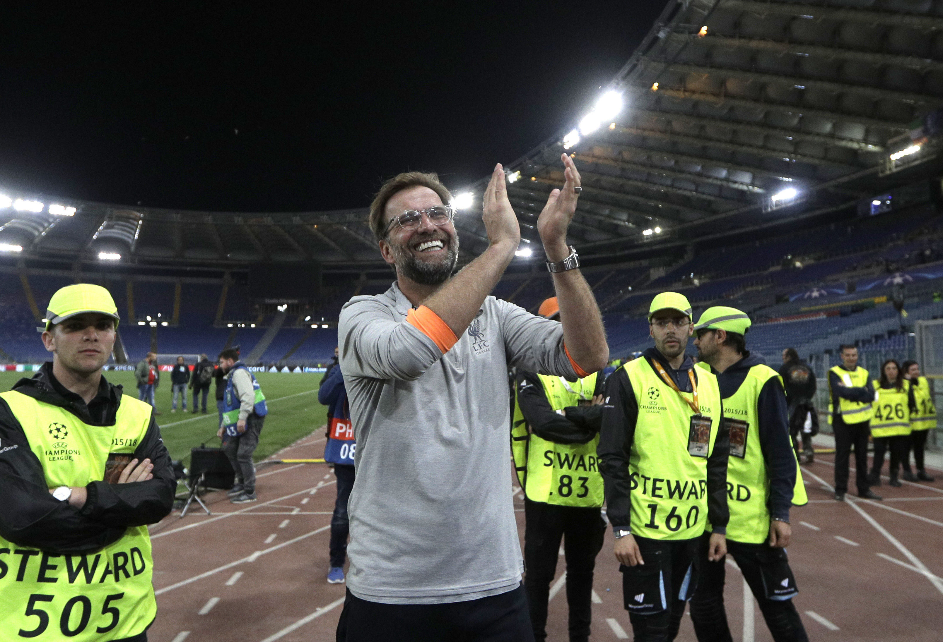 Liverpool coach Jurgen Klopp celebrates with the supporters at the end of the Champions League semifinal second leg soccer match between Roma and Liverpool at the Olympic Stadium in Rome, Wednesday, May 2, 2018