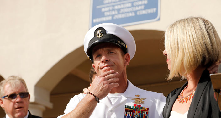 US Navy SEAL Special Operations Chief Edward Gallagher prepares to answer a question from the media