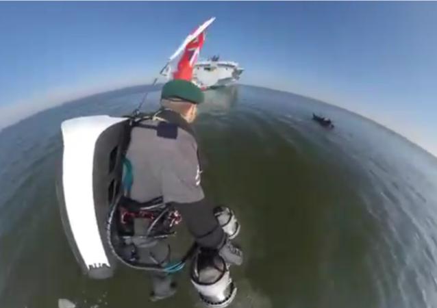 'Rocket Man' Performs Demo Flight Around Warship HMS Queen Elizabeth