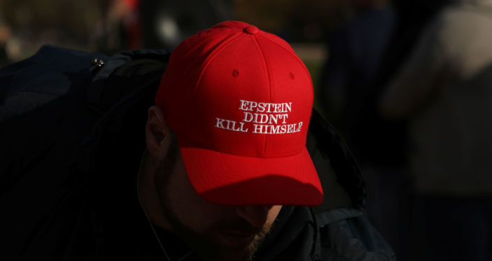 An attendee wears a hat that says Epstein Didn't Kill Himself as militia members and pro-gun rights activists participating in the Declaration of Restoration rally listen to speakers in Washington, D.C., U.S., November 9, 2019