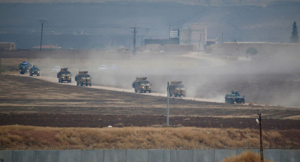 Turkish and Russian military vehicles return following a joint patrol in northeast Syria, as they are pictured from near the Turkish border town of Kiziltepe in Mardin province, Turkey, November 1, 2019.
