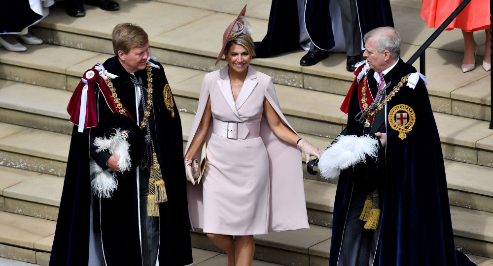 FILE PHOTO: Netherlands' Queen Maxima walks with Britain's Prince Andrew as they leave from St George's Chapel after the Order of the Garter Service at Windsor Castle, Britain June 17, 2019
