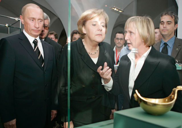 Russian President Vladimir Putin and German Chancellor Angela Merkel visiting the Green Vault in Dresden, Germany