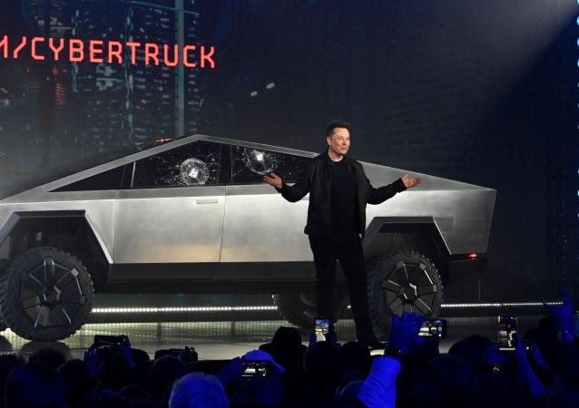 Nov 21, 2019;  Hawthorne, CA, U.S.A; Tesla CEO Elon Musk unveils the Cybertruck at the TeslaDesign Studio in Hawthorne, Calif.
