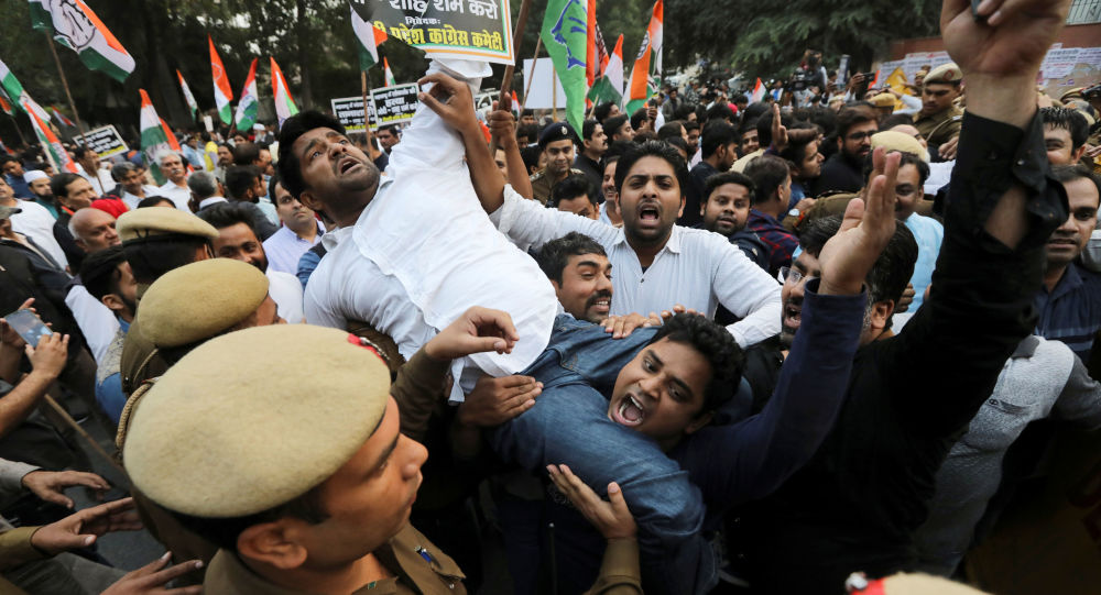 Supporters of India's main opposition Congress party shout slogans as they are stopped by police during a protest against the formation of a Bharatiya Janata Party (BJP) led coalition government in Maharashtra, in New Delhi, India November 25, 2019