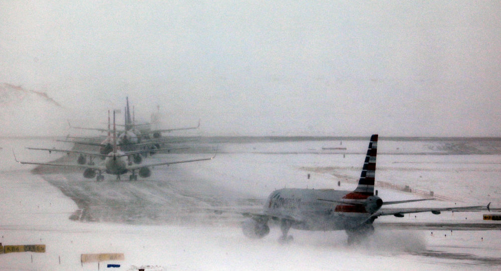 A line of jets wait to takeoff after a pre-Thanksgiving holiday snowstorm caused more than 460 flight cancellations at Denver International Airport, Colorado, U.S., November 26, 2019.