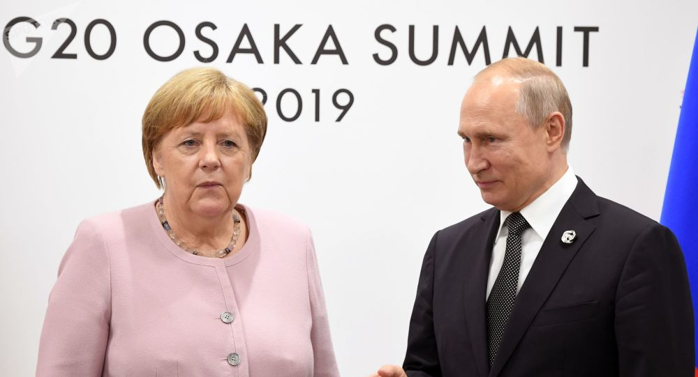 Russian President Vladimir Putin and German Chancellor Angela Merkel during a G20 meeting at the INTEX Osaka International Exhibition Center.