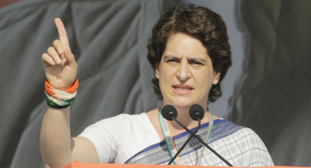 India's main opposition Congress party General Secretary Priyanka Gandhi Vadra speaks during a public meeting at Adalaj in Gandhinagar, India, Tuesday, March 12, 2019