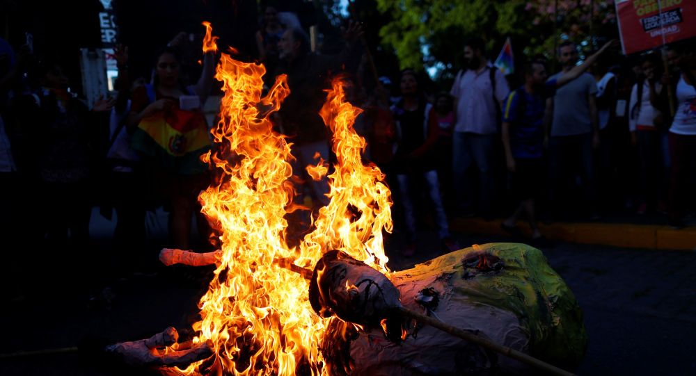 An effigy depicting U.S. President, Donald Trump is set on fire by supporters of Bolivia's ousted President Evo Morales outside the U.S. embassy in Buenos Aires