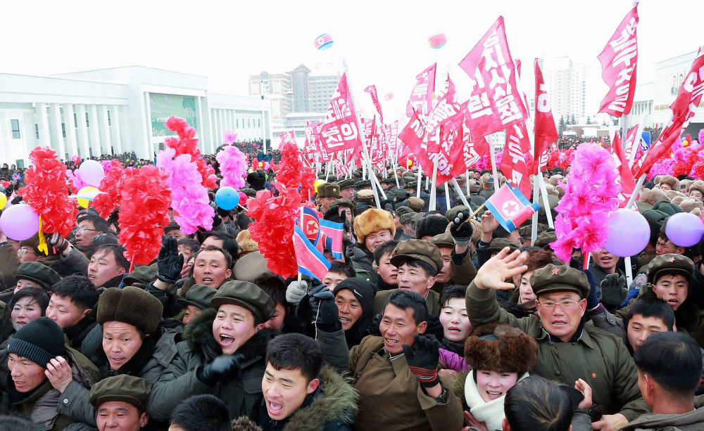 This picture taken on December 2, 2019 and released from North Korea's official Korean Central News Agency (KCNA) on December 3, 2019 shows residents attending a ceremony to mark the completion of the construction of the township of Samjiyon County.