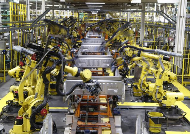 In this Sept. 27, 2018, file photo robots weld the bed of a 2018 Ford F-150 truck on the assembly line at the Ford Rouge assembly plant in Dearborn, Mich.