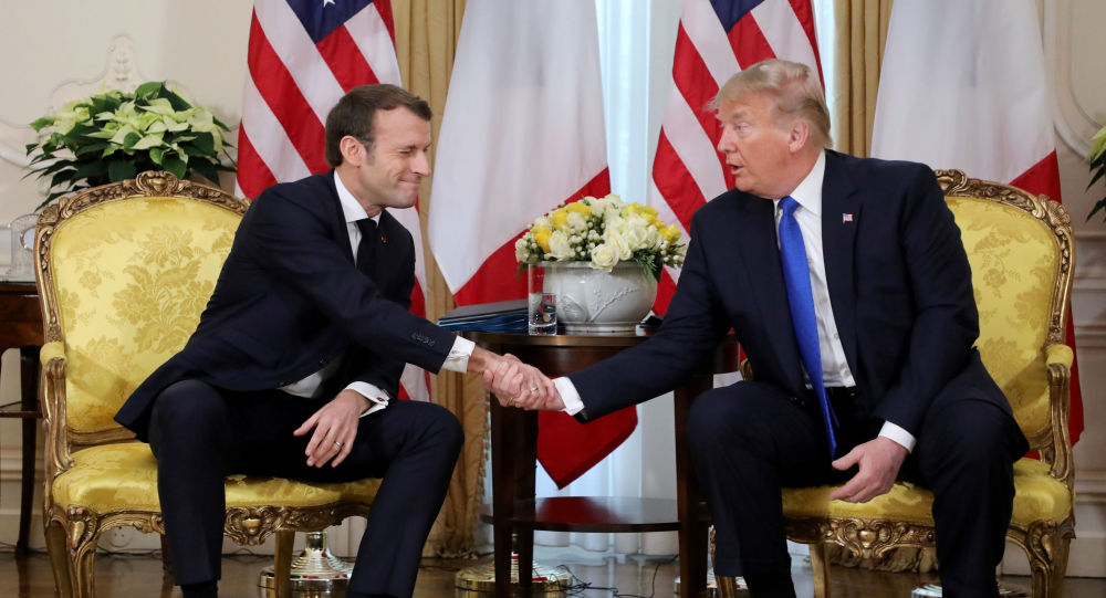 U.S. President Donald Trump shakes hands with France's President Emmanuel Macron, ahead of the NATO summit in Watford, in London, Britain, December 3, 2019
