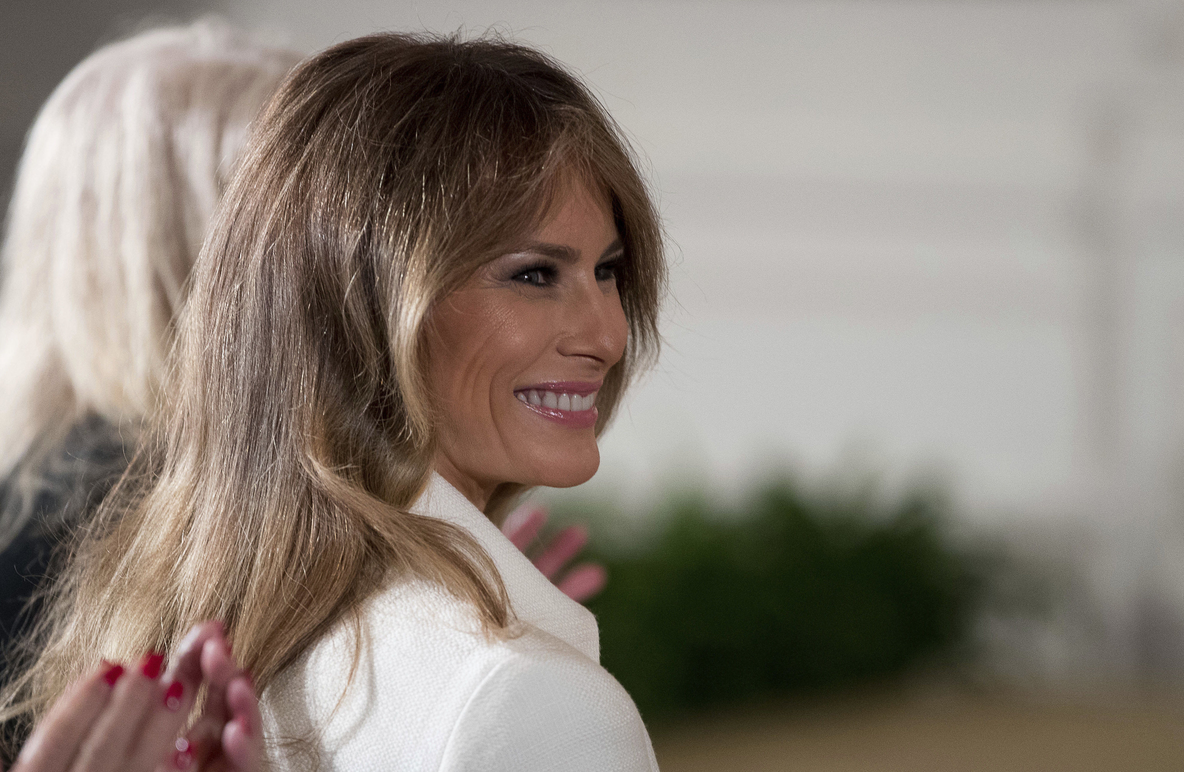 U.S. first lady Melania Trump smiles as she is recognized by President Donald Trump