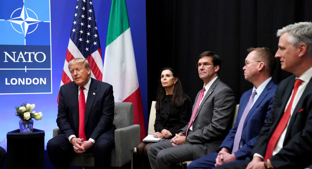 U.S. President Donald Trump speaks as U.S. Defense Secretary Mark Esper and Acting White House Chief of Staff Mick Mulvaney look on during a bilateral meeting with Italian Prime Minister Giuseppe Conte on the sidelines of the NATO summit in Watford, Britain, December 4, 2019. REUTERS/Kevin Lamarque