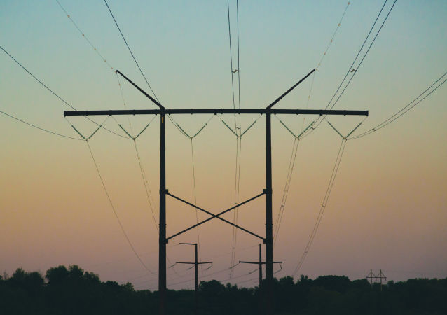 Electrical power lines along Great River Road near Trempealeau, Wisconsin, at sunset