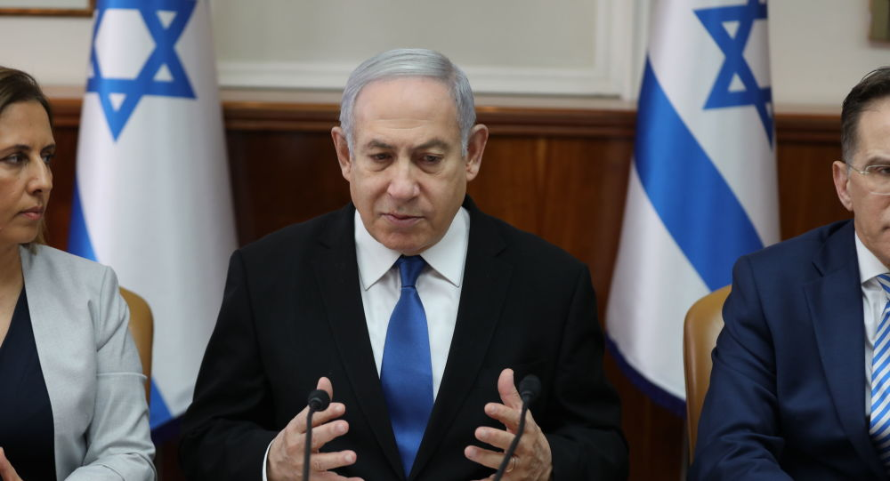 Israeli Prime Minister Benjamin Netanyahu chairs the weekly cabinet meeting at his office in Jerusalem on December 1, 2019.