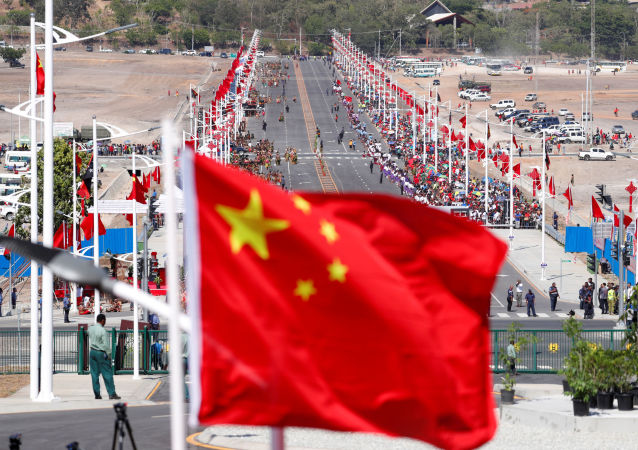 A Chinese national flag flies in front of a Chinese-built main road, before a welcome ceremony for China's President Xi Jinping ahead of the APEC Summit in Port Moresby, Papua New Guinea November 16, 2018
