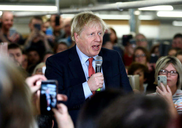 Britain's Prime Minister Boris Johnson delivers a speech to workers during a Conservative Party general election campaign visit to John Smedley Mill in Matlock, central England, on December 5, 2019.