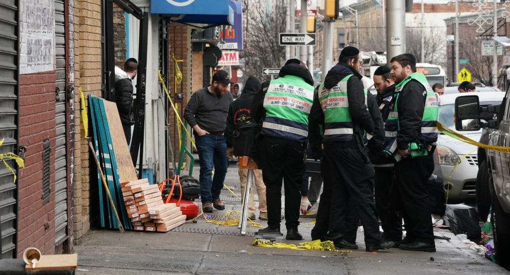 A demolition and recovery crew works at the scene of the December 10, 2019 shooting at a Jewish Deli on December 11, 2019 in Jersey City.