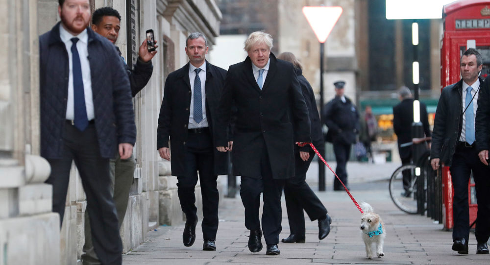 Britain's Prime Minister Boris Johnson arrives with his dog Dilyn at a polling station at the Methodist Central Hall to vote in the general election in London, Britain, December 12, 2019