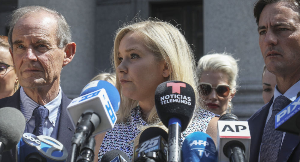 In this Aug. 27, 2019, photo, Virginia Roberts Giuffre, center, who says she was trafficked by sex offender Jeffrey Epstein, holds a news conference outside a Manhattan court where sexual assault claimants invited by a judge addressed a hearing following Epstein's jailhouse death in New York