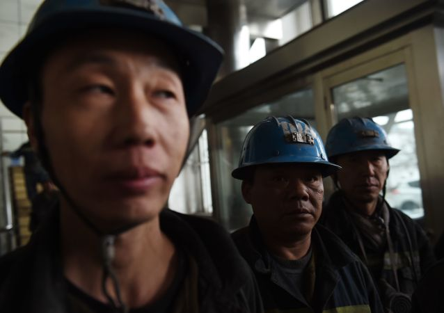 In this photo taken on November 19, 2015, coal miners wait to enter a mine at Datong, in China's northern Shanxi province.