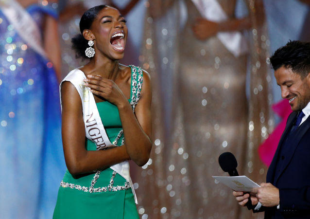 Nyekachi Douglas of Nigeria reacts on stage during the Miss World final in London