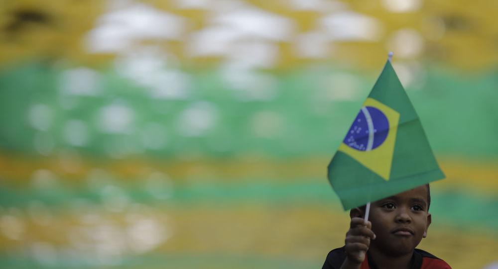 Child Waves a Brazilian Flag