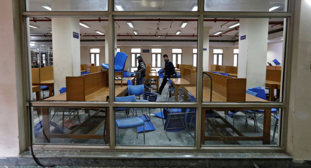 People walk inside a partially damaged library of the Jamia Millia Islamia university after police entered the university campus on the previous day, following a protest against a new citizenship law, in New Delhi, India, December 16, 2019