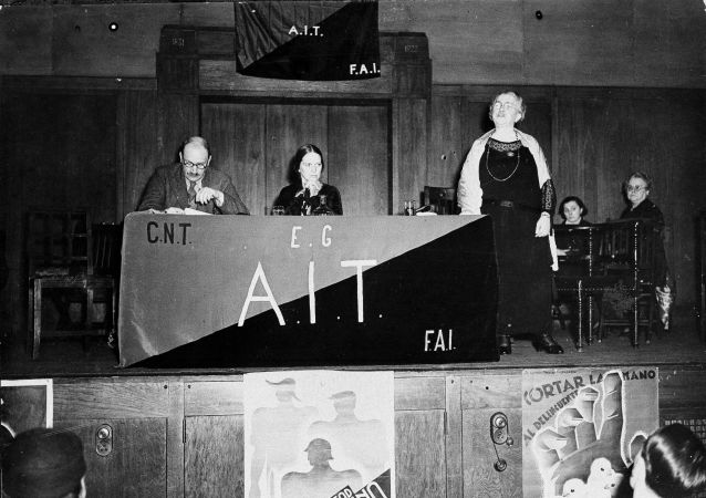Emma Goldman, who had just returned from a visit to Spain, addresses an anarchist meeting in London in 1937