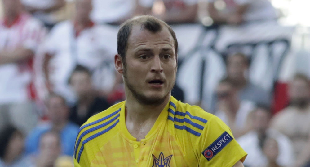 "FILE - In this Tuesday, June 21, 2016 file photo, Ukraine's Roman Zozulya protest to a referee during the Euro 2016 Group C soccer match between Ukraine and Poland at the Velodrome stadium in Marseille, France.  The Ukrainian player called ""a Nazi"" by fans in a Spanish second-division match suspended because of the insults had already been targeted by fans last season. The game between Rayo Vallecano and Albacete  on Sunday, Dec. 15, 2019 was halted at halftime after Rayo fans used abusive language against Zozulia in chants and a in a banner. (AP Photo/Ariel Schalit, File)"
